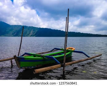 Beautiful Lake Water Beratan Scenery With Traditional Paddle Canoe At Bedugul, Tabanan, Bali, Indonesia