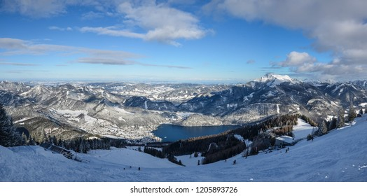 Beautiful lake Wolfgangsee in upper Austria. This picture was taken in winter from mountain Zwolferhorn. That day was nice weather and some clouds