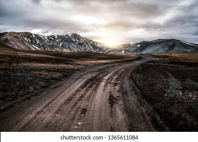 Beautiful Landmanalaugar gravel dust road way on highland of Iceland, Europe. Muddy tough terrain for extreme 4WD 4x4 vehicle. Landmanalaugar landscape is famous for nature trekking and hiking.