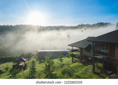 Beautiful landscape above the cloud with house, home, hotel, resort on the peak of the mountains view with heavy mist , cloud and fog in the morning at Khao Kor , Thailand