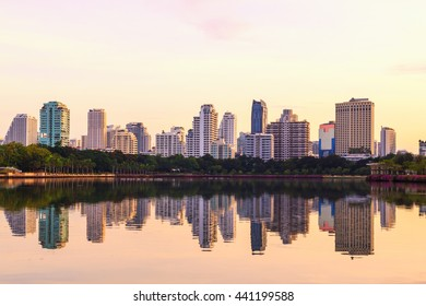 Beautiful landscape abstract city blur background .Panoramic and perspective  view to steel light blue background of glass high rise building skyscraper commercial modern city of future.pastel tone.