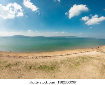 beautiful landscape. Aerial view of beach and coast of Irish Sea in Holywood, Northern Ireland. Horizon over water against blue sky