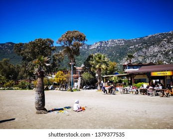 Beautiful landscape of Akyaka beach, People are chilling on the beach, Akyaka, Mugla, Turkey, 22.04.2019