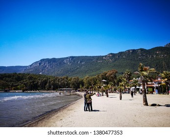 Beautiful landscape of Akyaka beach and people are chilling, Akyaka, Mugla, Turkey, 22.04.2019