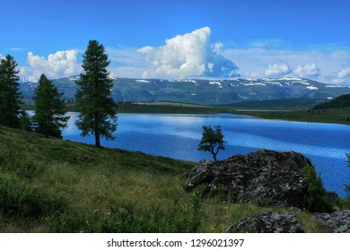 Beautiful landscape in the Altai Republic in Russia. View on the shore of the mountain lake Uzunkol