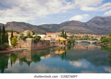Beautiful landscape with an ancient city on the river bank.  Bosnia and Herzegovina, view of Trebisnjica river and Old Town of Trebinje