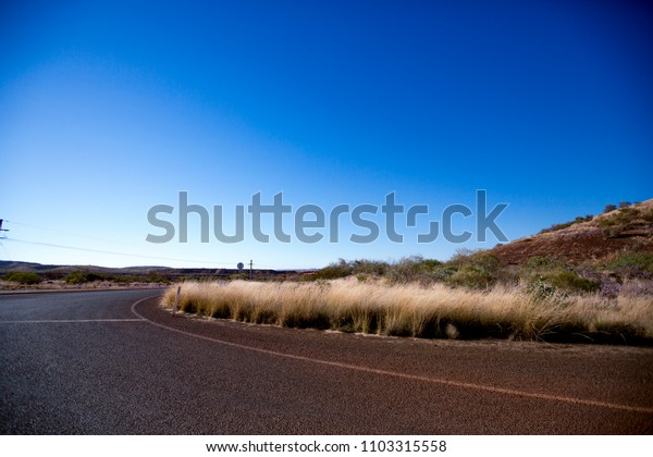 Beautiful landscape of Australian outback road during the midday mine site Perth Australia