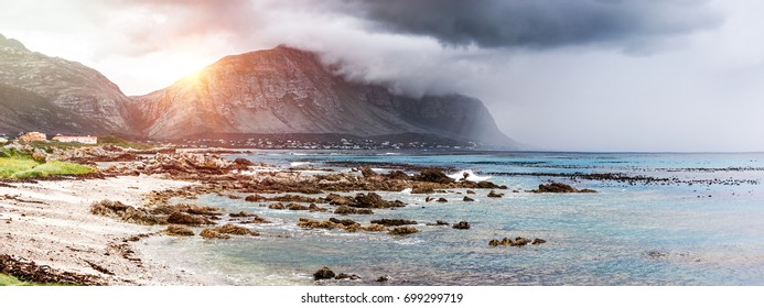 Beautiful landscape of Bettys Bay, mountains in the fog near seashore, amazing panoramic view, beauty of wild nature, Atlantic Ocean, South Africa