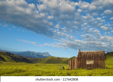 beautiful landscape of blue sky, mountain and rustic lodge