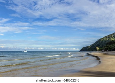 Beautiful landscape of blue sky sea and white waves on 'White sand beach' of Koh Chang island, one of the tourist attraction of gulf of Thailand in Trat province with a stopped yacht
