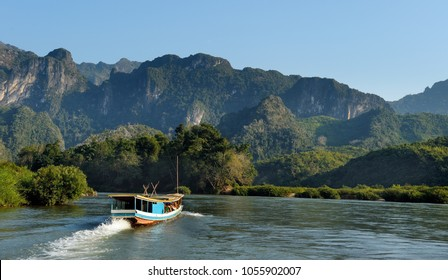 Beautiful landscape with boat tour at Mekong river near Luang Prabang in Laos.
