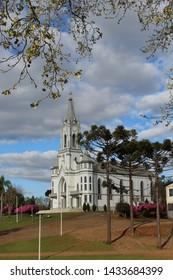 Beautiful landscape of a Brazilian Catholic church with araucaria tree. Aurea - Rio Grande do Sul