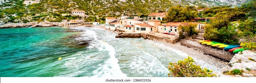 Beautiful landscape of Calanque de Sormiou, cropped image horizontal view, turquoise sea surf sea foam. South France