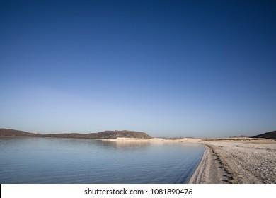 beautiful landscape with calm lake and white sand on shore at sunny day, salda golu, turkey