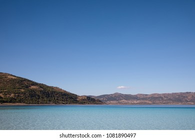 beautiful landscape with calm water and mountains on shore at sunny day, salda golu, turkey