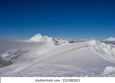 Beautiful landscape of Caucasus Mountains on ski resort Krasnaya Polyana on background clear sky