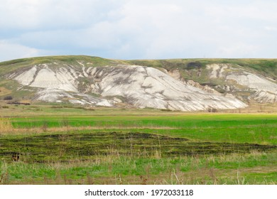Beautiful landscape, chalk mountain against the sky and green grass on a sunny spring day, clear weather.Photo. - Shutterstock ID 1972033118