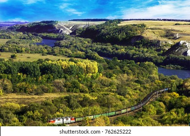beautiful landscape with chalk mountains, train, autumn forest, river valley in countryside, divnogorie, central russia, voronezh