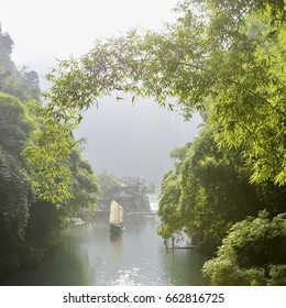 Beautiful landscape with Chinese fishing boat sailing at the Three Gorges Tribe scenic spot.