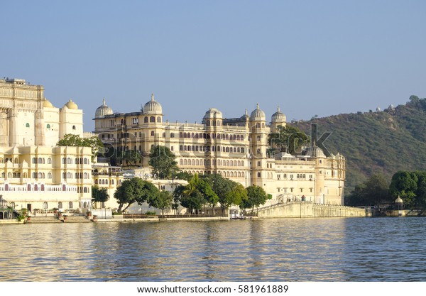 Beautiful landscape of the city on water at sunset in India Udaipur