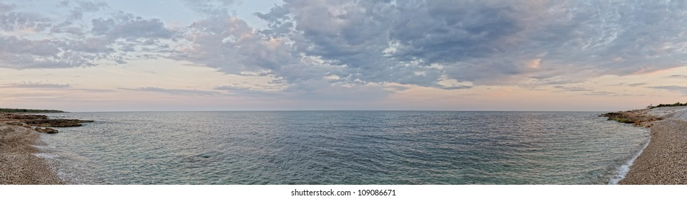 Beautiful landscape with coast of the sea. Sunset sky. Spain. Pamoramic view.