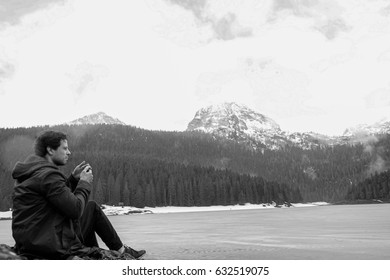 Beautiful landscape. Crno Lake. National park Durmitor and Black Lake. Zhablyak, Montenegro.The young girl the tourist, the young guy sits looks at a landscape