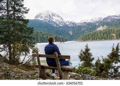 Beautiful landscape. Crno Lake. National park Durmitor and Black Lake. Zhablyak, Montenegro. The man on a bench looks at a landscape