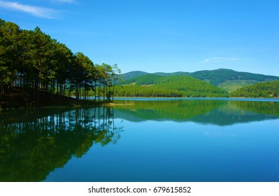 Beautiful landscape at Dalat countryside for eco tour, pine tree reflect on water of Tuyen Lam lake, green scene with fresh air for Vietnam travel