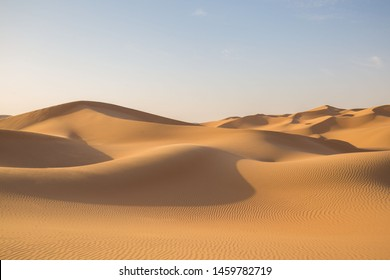 Beautiful landscape in desert Liwa. Amazing dune Moreeb in United Arab Emirates. Golden waves of sand. Nature  safari panorama. Travel view.