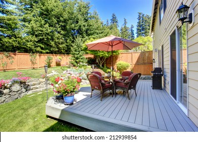 Beautiful landscape design for backyard garden and patio area on walkout deck