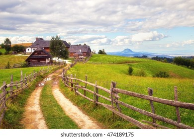 Beautiful landscape with dirt road leading to a farm
