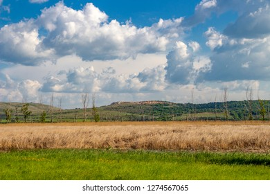 Beautiful landscape with Dragoman natural karst Marsh in Sofia Province, Bulgaria - the biggest Bulgarian natural karst wetland with covered with clouds beautiful May sky