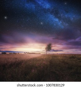 Beautiful landscape with field under sky with starrs. Polish landscape.