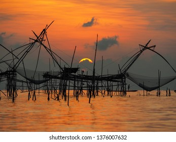 "Beautiful landscape with fishing tool called ""Yor"" in the sea while the sun is rising up at fisherman village, Ban Pakpra, Phatthalung, south of Thailand."