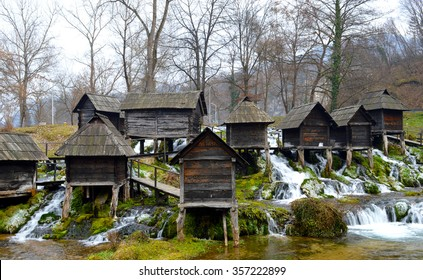 Beautiful landscape with forest river and old wooden water mills. Popular touristic site, ancient village near city Jaycee in Bosnia and Herzegovina.