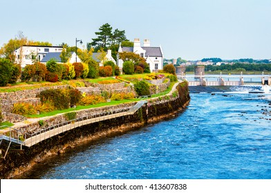Beautiful landscape of Galway, Ireland. River and houses with clear blue sky