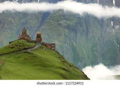 Beautiful landscape with Gergeti Trinity Church on top of mountain near Gergeti village