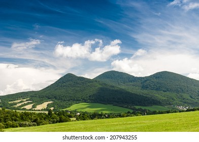 Beautiful landscape. Green hills and blue sky with white clouds