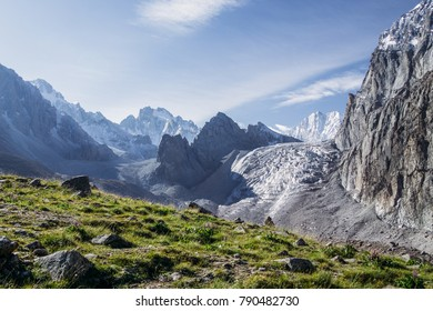 beautiful landscape with green vegetation and snow capped rocky mountains, kyrgyzstan, ala archa