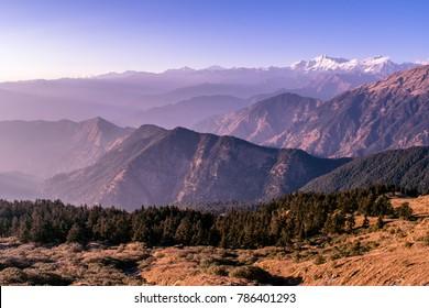 Beautiful landscape of Himalayan snow mountains from Chandrashila peak in Chopta, Uttarakhand, India