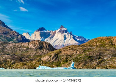 Beautiful landscape with Iceberg floating in the lake grey infront of the beautiful mountain at Torres del Paine National Park in Chile