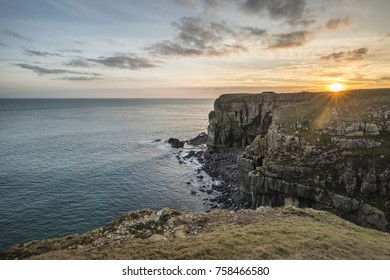 Beautiful landscape image of cliffs around St Govan's Head on Pembrokeshire Coast in Wales