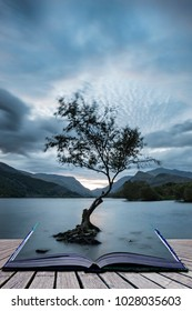 Beautiful landscape image of Llyn Padarn at sunrise in Snowfonia National Park in pages of imaginary story book