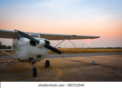 beautiful landscape image with old wing airplane at sunset