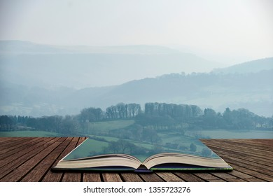 Beautiful landscape image of the Peak District in England on a hazy Winter day in pages of open book, story telling concept