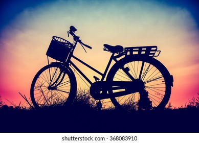 beautiful landscape image with silhouette Bicycle at sunset for background,.classic bicycle,old bicycle style for greeting Cards ,post card