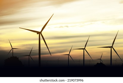 beautiful landscape image with Windturbine farm at the sunset