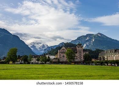 Beautiful landscape of Interlaken downtown with jungfrau peak behide, Switzerland.