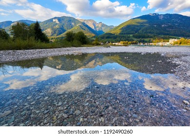 Beautiful landscape with lake, mountains, forest, clouds and reflection in water. Austria, Salzkammergut, Wolfgangsee.