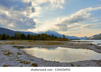 Beautiful landscape with lake, mountains, forest, clouds and reflection in water. Austria, Salzkammergut, Wolfgangsee